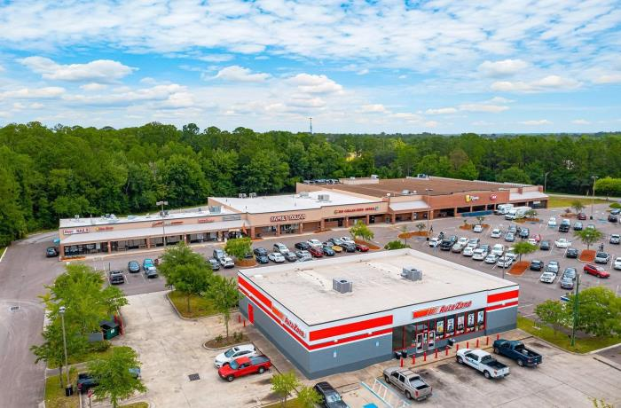 Aerial view of very large shopping center including the parking lot and Autozone.